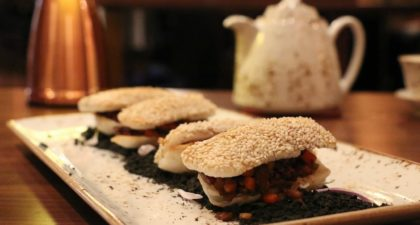 Shanghai Magic: Stir-fried Minced Duck Soy Sprouts Served on Northern Style Sesame Pastry